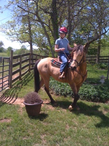 Olivia and High Hope working around a flower pot