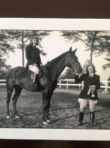 Mom (standing) and Auntie Bliss on one of their school horses at Arlington Hall after a show.